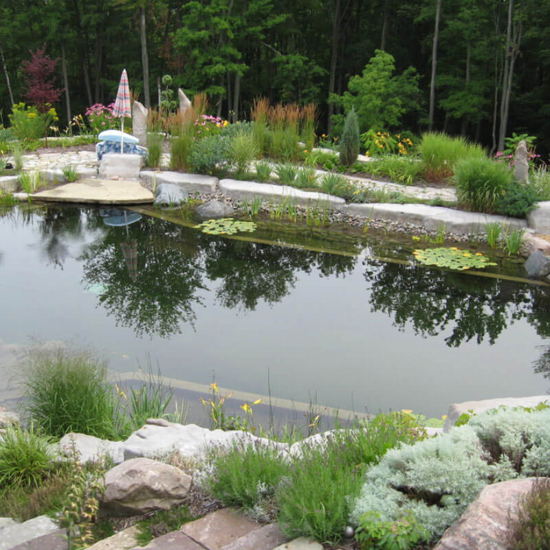 Large residential pond construction mi 2